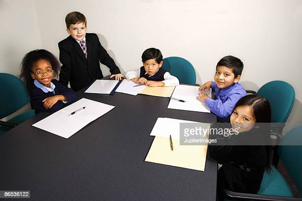 Children at mock business meeting