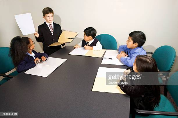 Children at mock business presentation