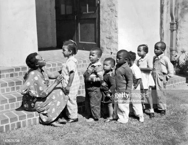 Children at the Prescott School get a morning inspection as part of the Emergency Education Program under the Public Works Adminstration Oakland...