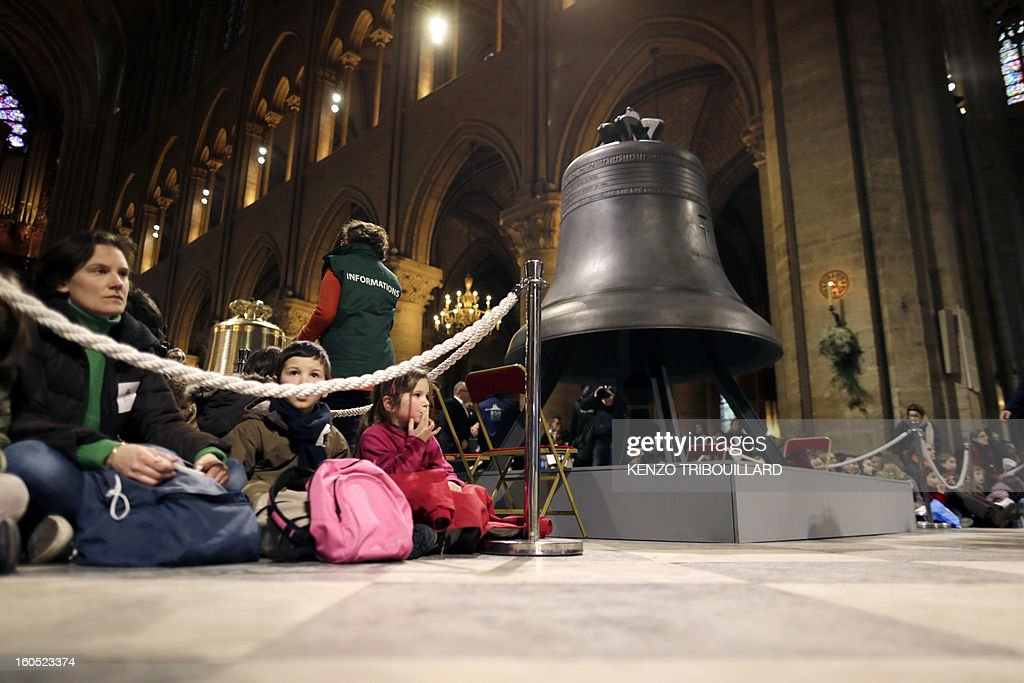 Children attend a ceremony to inaugurate nine new church bells on February 2, 2013 at Notre-Dame de Paris Cathedral in Paris. Hundreds of pupils attend the ceremony during a jubilee.