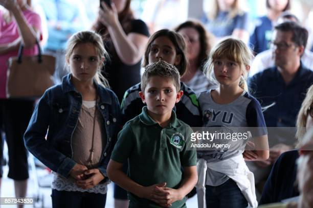 Children attend a memorial for Las Vegas mass shooting victims who lost their lives after a gunman attack in Las Vegas NV United States on October 3...