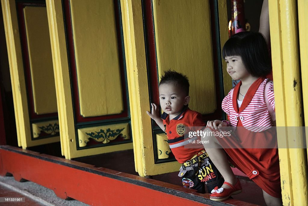 Children attend a temple during Chinese New Year celebrations on February 10, 2013 in Bintan Island, Indonesia. Chinese people around the world are ushering in the Year of the Snake with prayers, feasts and fireworks.