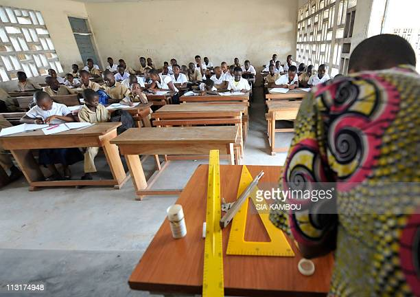 Children attend class on April 26 2011 in the BAD college in the Koumassi popular neighborhood of Abidjan as the governemnt of Alassane Ouattarasa...