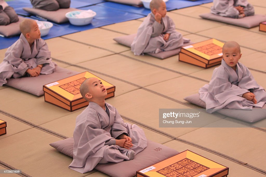 Children attend during the 'Children Becoming Buddhist Monks' ceremony forthcoming buddha's birthday at a Chogye temple on May 11, 2015 in Seoul, South Korea. Children have their hair shaved off during the 'Children Becoming Buddhist Monks' ceremony ahead of buddha's birthday at a Chogye temple. The children will stay at the temple to learn about Buddhism for 14 days. Buddha was born approximately 2,559 years ago, and although the exact date is unknown, Buddha's official birthday is celebrated on the full moon in May in South Korea, which is on May 25 this year.