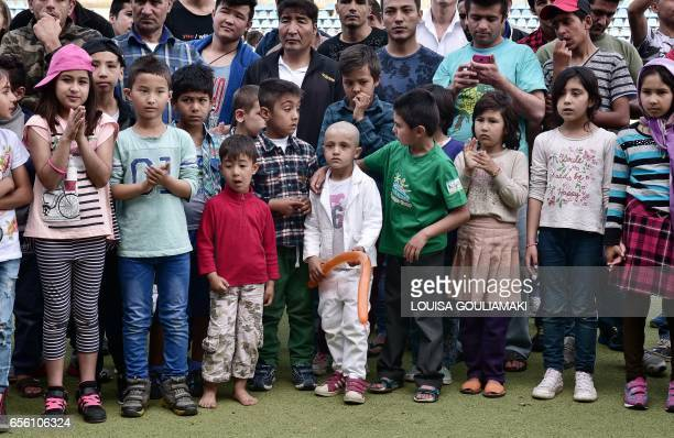 Children attend the celebrations of Nauroz 'New day' the traditional Afghan New Year's Day on March 21 2017 at the Hockey refugee camp situated at...