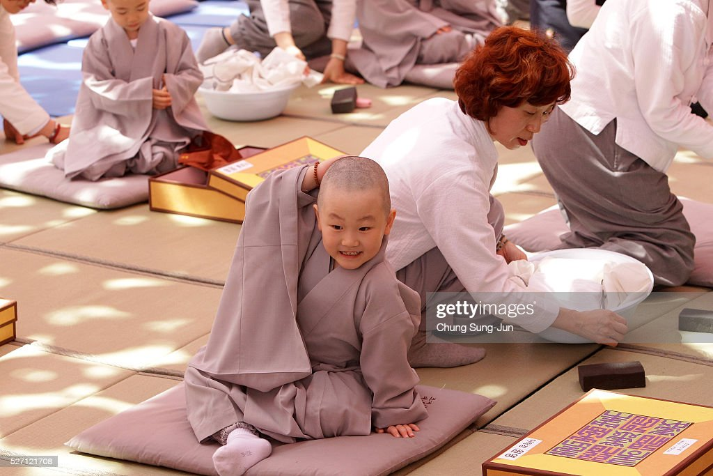 Children attend the 'Children Becoming Buddhist Monks' ceremony forthcoming buddha's birthday at a Chogye temple on May 2, 2016 in Seoul, South Korea. Children have their hair shaved off during the 'Children Becoming Buddhist Monks' ceremony ahead of buddha's birthday at a Chogye temple. The children will stay at the temple to learn about Buddhism for 14 days. Buddha was born approximately 2,560 years ago, and although the exact date is unknown, Buddha's official birthday is celebrated on the full moon in May in South Korea, which is on May 14 this year.
