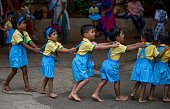 Children attend the first day of school at Mahila Sandh at Vile Parle on June 15 2016 in Mumbai India Attired in brandnew uniforms the children...