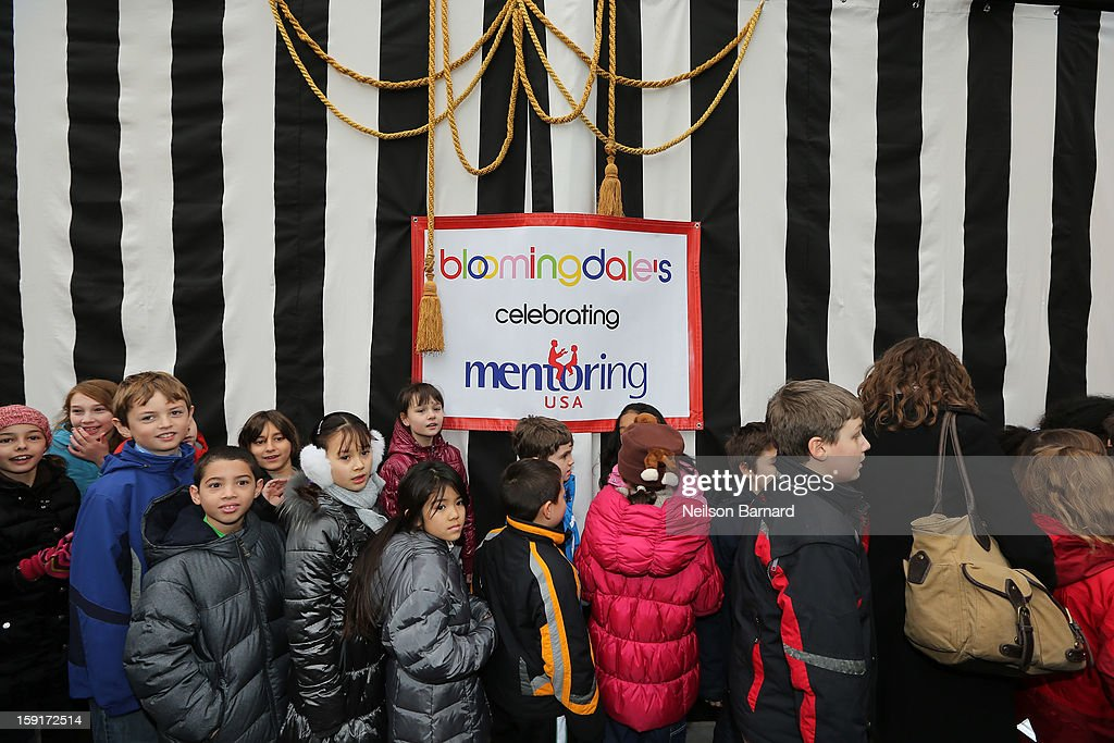 Children attend the unveiling of the Bloomingdale's Mentoring USA window displaying children's artwork at Bloomingdale's 59th St. and Mentoring USA's celebration of National Mentoring Month on January 9, 2013 in New York City.
