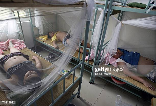 Children attending a weightloss summer camp organized by the Aimin Slimming Centre receive acupuncture treatments July 11 2006 in Wuhan of Hubei...