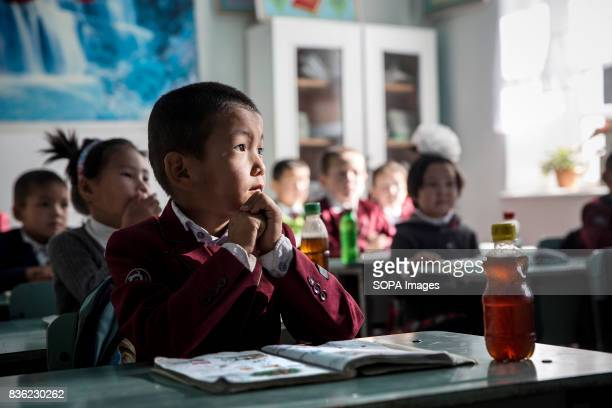 Children attending school in the village of Beshkent Kyrgyzstan The school lacks running water and therefore drinking water is gathered from a nearby...