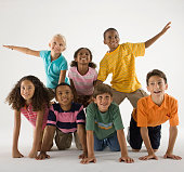 Children Balancing on Each Other