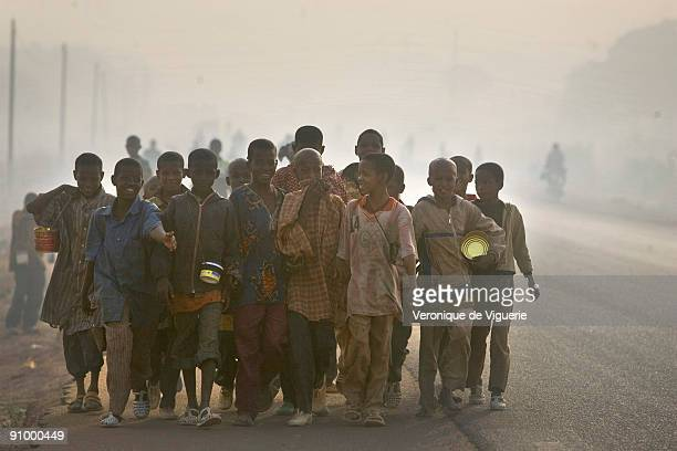 Children begging in the streets of Korogho Ivory Coast where hundreds of children are coming from poorer neighbouring countries like Mali Guinea and...