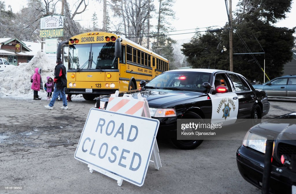 Children board a school bus a day after a standoff between law enforcement officers and who is believed to be suspected murderer and former Los Angeles Police Department officer Christopher Dorner on February 13, 2013 in Angelus Oaks, California. Dorner allegedly barricaded himself in a cabin near Big Bear, California, and engaged law enforcement officers in shootout, shooting two police, killing one. Dorner, a former Los Angeles Police Department officer and Navy Reserve veteran, is wanted in connection with the deaths of an Irvine couple and a Riverside police officer.