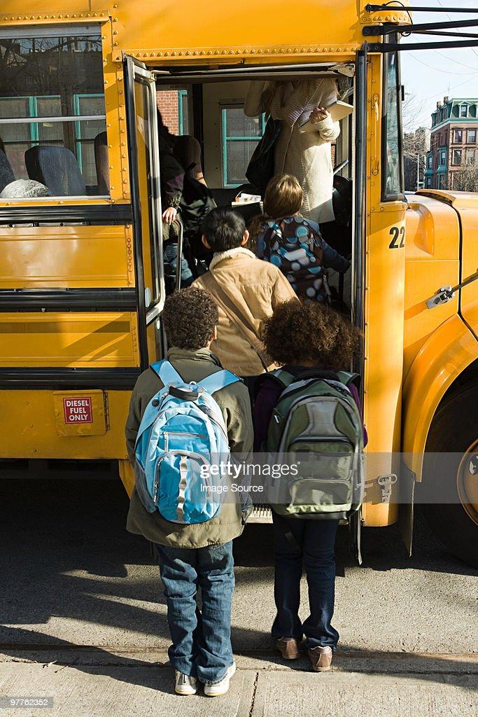 Children boarding school bus : Stock Photo