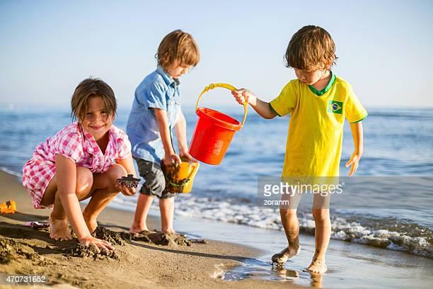 children build a sand castle