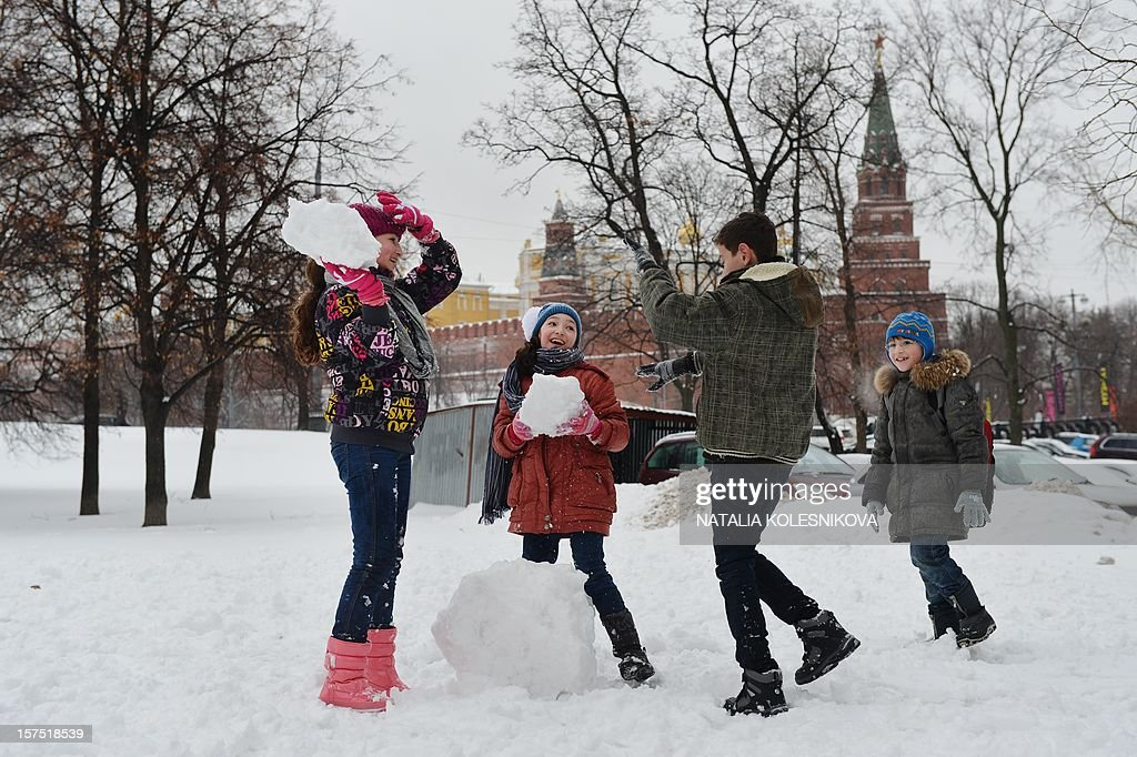 Children build a snowman in the Aleksandrovsky (Alexander's) Garden just outside the Kremlin in Moscow, on December 4, 2012. Moscovites woke up today to a thick blanket of snow covering the Russian capital.The temperatures in Moscow reached today 1C (34 F), but due to high humidity and wind, weather experts said it would feel more like - 3C (25 F).