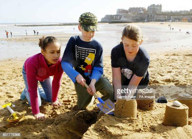 Children build sandcastles on Broadstairs beach in Kent today after unseasonal snow hit parts of Kent East Sussex and West Sussex overnight