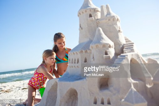 Children building sand castle on the beach