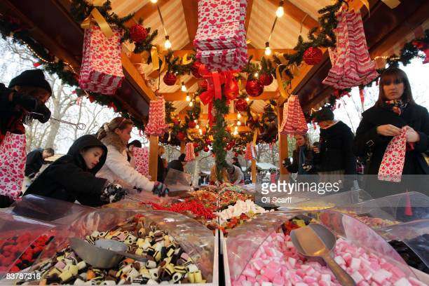 Children buy sweets from a stall in the German market set up in Hyde Park on the first day of the 'Winter Wonderland' experience on November 22 2008...