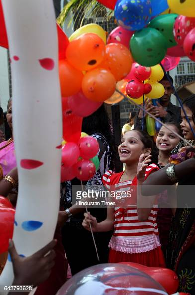 Children buying balloons during Christmas celebrations after attending the mass Outside the Sacred Heart Church khar on Saturday Morning