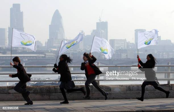 Children carry banners as they run along the South Bank in central London during the filming of the penultimate leg of US billionaire philanthropist...
