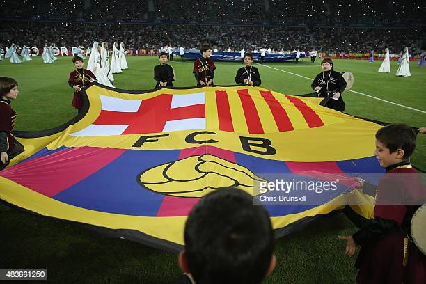 Children carry the Barcelona flag ahead of the UEFA Super Cup between Barcelona and Sevilla FC at Dinamo Arena on August 11 2015 in Tbilisi Georgia