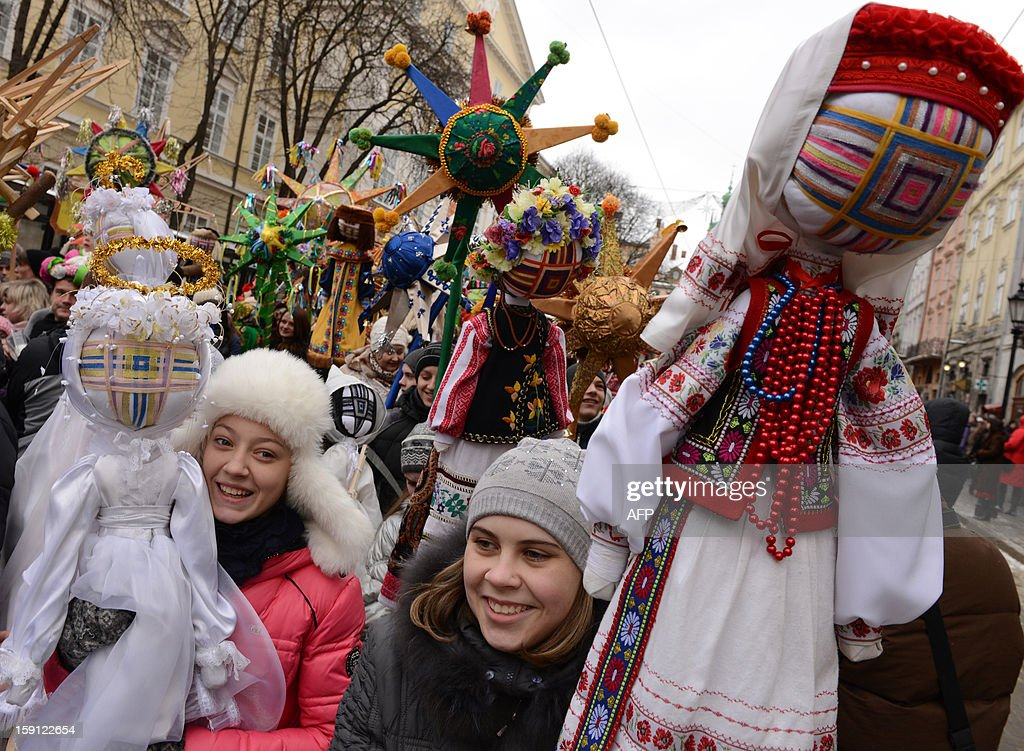 Children carry traditional dolls as they walk in the center of the western Ukrainian city of Lviv during Christian Orthodox Christmas celebrations on January 8, 2013.