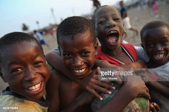 Children celebrate a soccer goal while playing in the West Point township on January 31 2015 in Monrovia Liberia Life has begun to slowly return to...