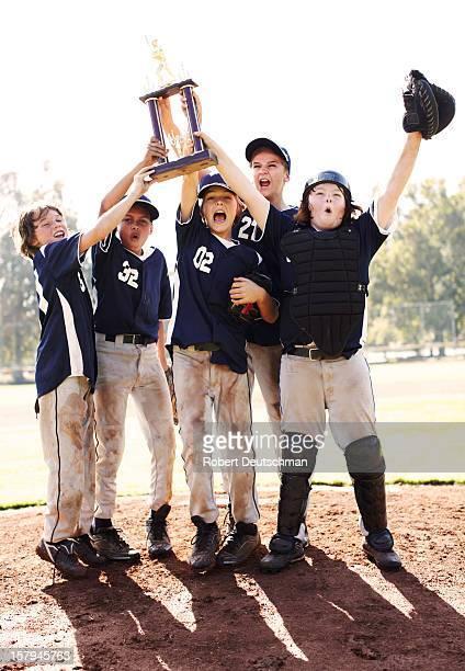 Children celebrating after a baseball game.