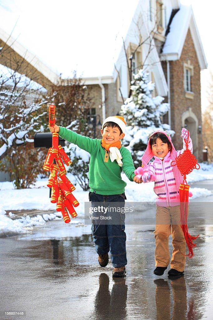 Children celebrating Chinese New Year : Stock Photo