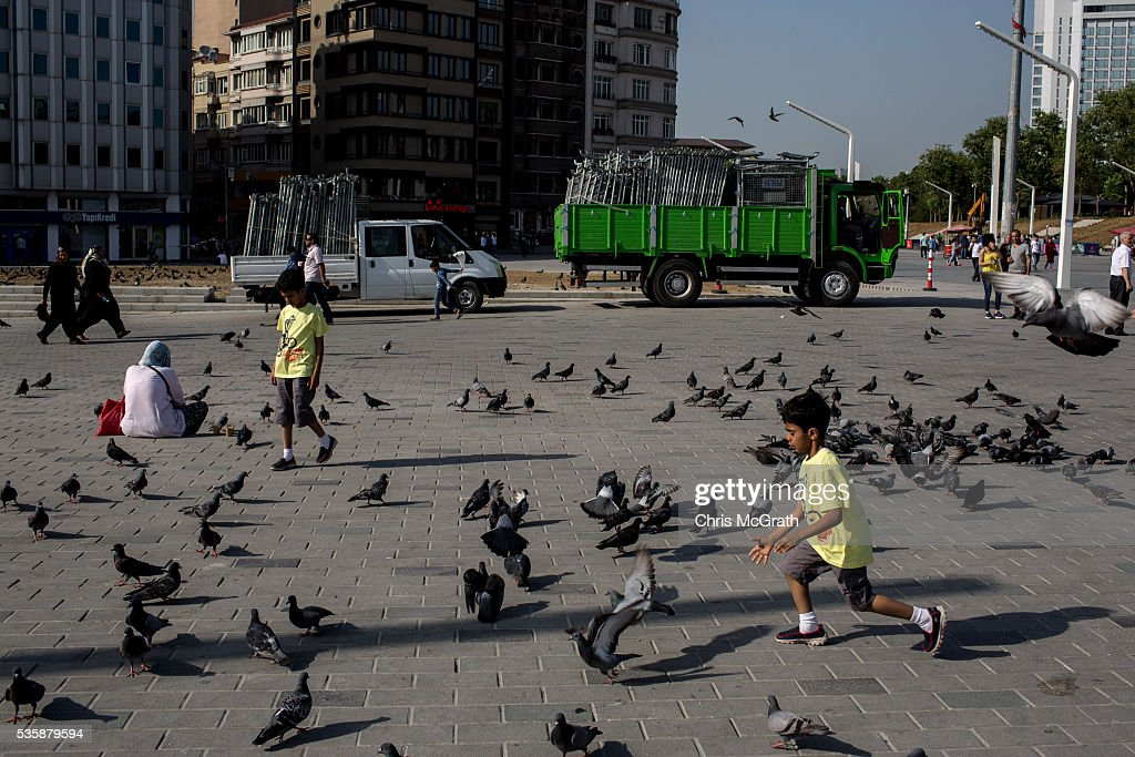Children chase pigeons in front of trucks filled with police barricades in Taksim Square on the eve of the 3rd anniversary of the Gezi Park protests on May 30, 2016 in Istanbul, Turkey. The protests began on May 28, 2013 to contest the planned urban development of Gezi Park however larger protests started after police evicted protesters from the park sparking weeks of civil unrest.