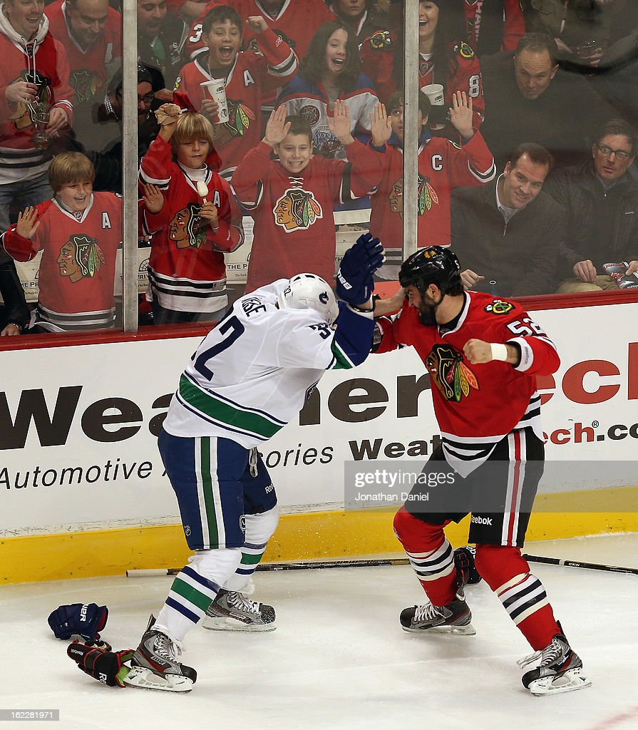 Children cheer as <a gi-track='captionPersonalityLinkClicked' href=/galleries/search?phrase=Brandon+Bollig&family=editorial&specificpeople=7186858 ng-click='$event.stopPropagation()'>Brandon Bollig</a> #52 of the Chicago Blackhawks fights with <a gi-track='captionPersonalityLinkClicked' href=/galleries/search?phrase=Dale+Weise&family=editorial&specificpeople=5527418 ng-click='$event.stopPropagation()'>Dale Weise</a> #32 of the Vancouver Canucks at the United Center on February 19, 2013 in Chicago, Illinois. The Blackhawks defeated the Canucks 4-3 in a shootout.