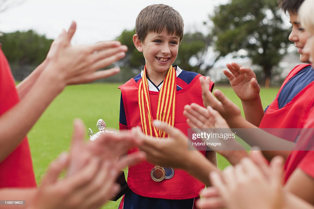 Children Cheering Teammate With Trophy Stock Photo | Getty ...
