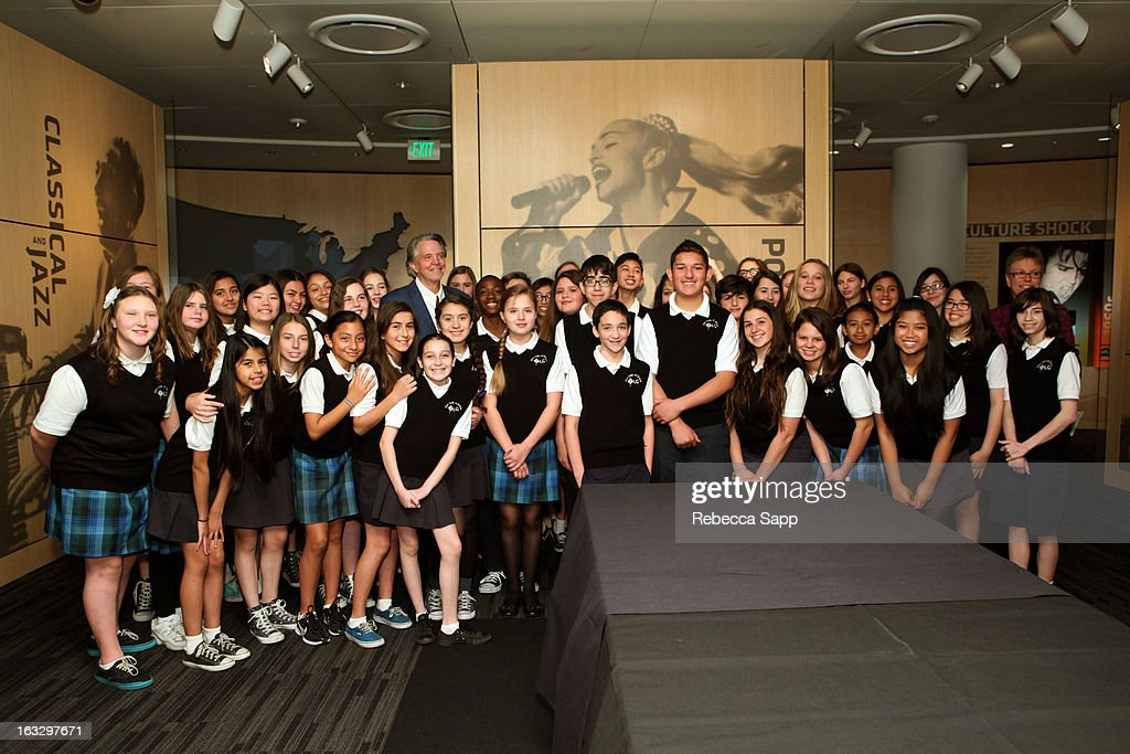 Children choir poses with musician Mike Curb at the Mike Curb Gallery Opening at The GRAMMY Museum on March 7, 2013 in Los Angeles, California.