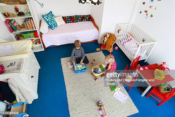 Children cleaning up messy nursery