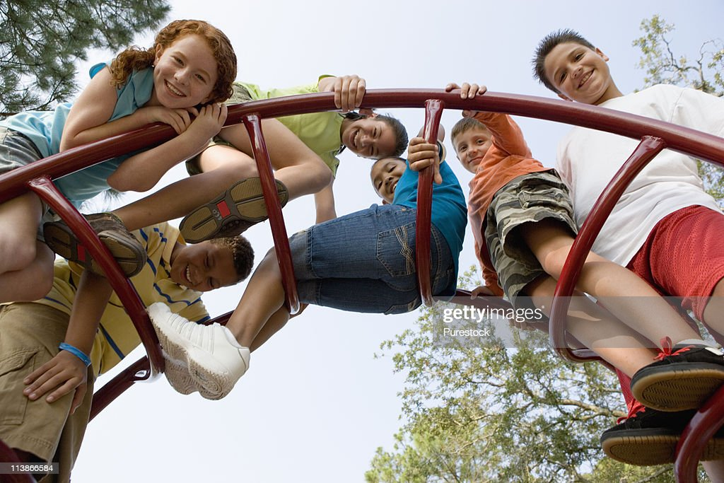 Children climbing on monkey bars at a playground