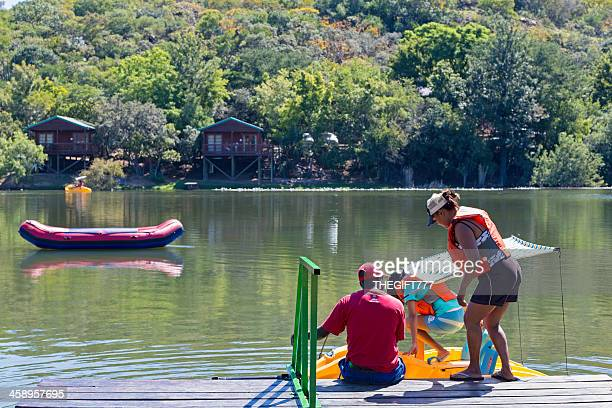 Children climbing on paddle boats at Klein Kariba lake