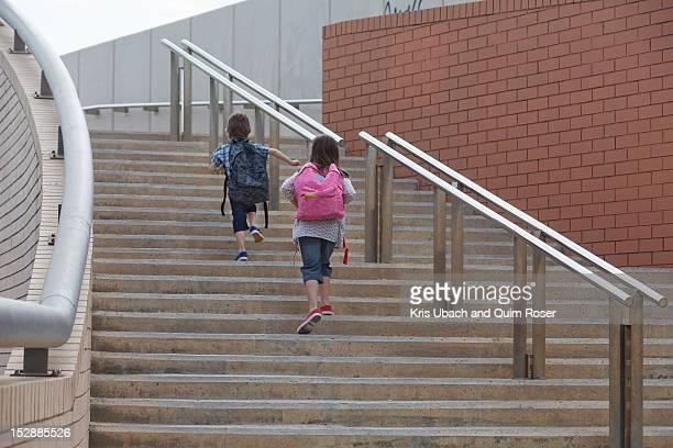 Children climbing stairs outdoors