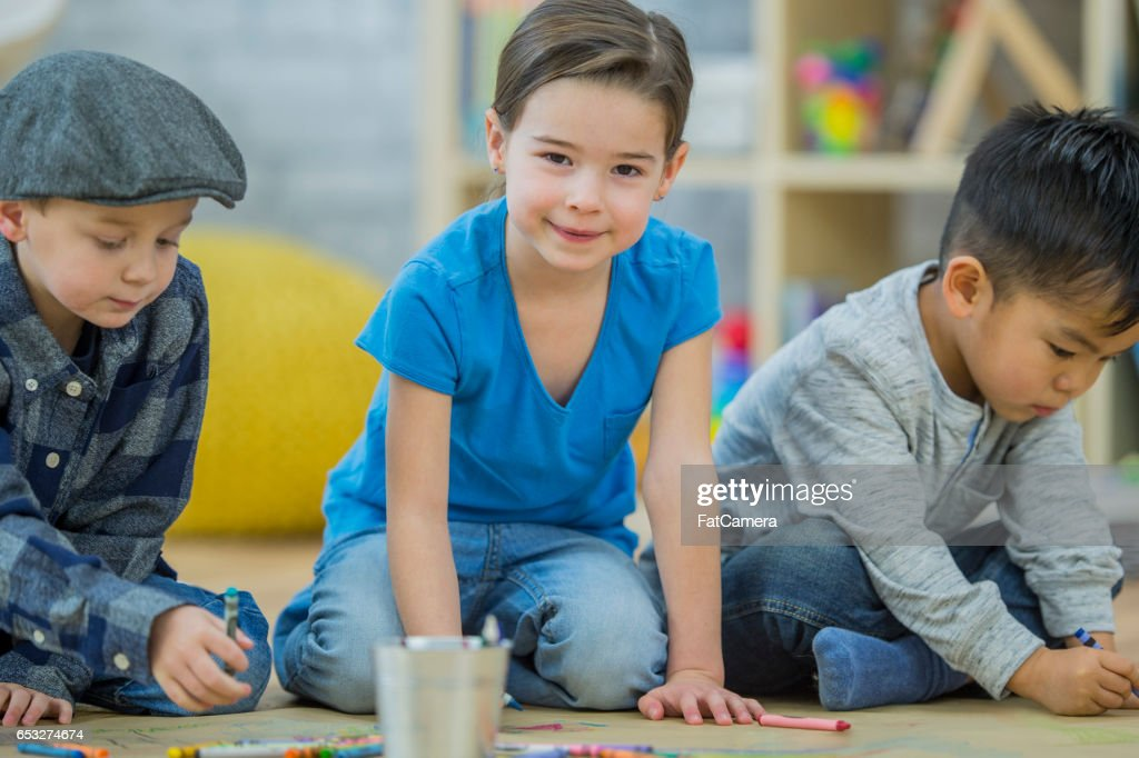 Children Coloring Together : Stock Photo