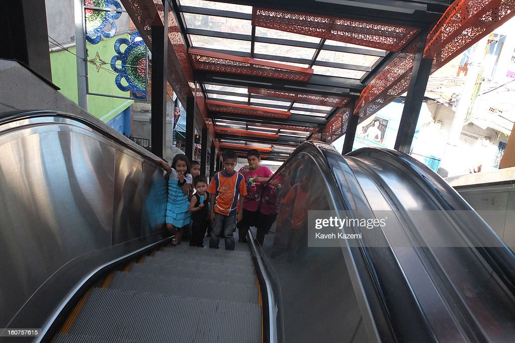 Children come up the escalators in '20 de Julio' neighborhood in the Comuna 13 slums on January 5, 2013 in Medellin, Colombia. The stairway is divided into six sections and has a length of 1,260 feet. An escalator goes up and a second goes down.Residents used to climb hundreds of steps to get home from the bottom of the hill, but the journey now takes just 6 minutes. Comuna 13 is the most notorious slums of Medellin with violence occurring everyday.