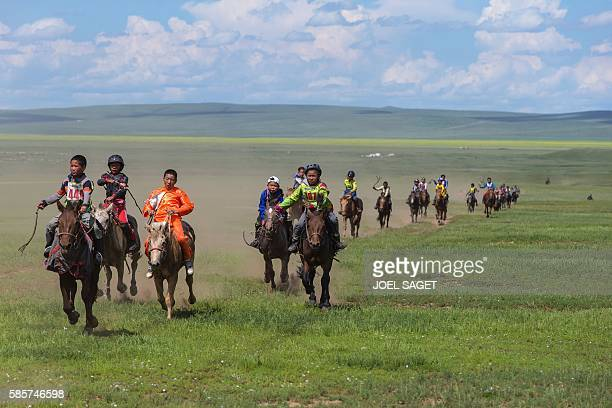 Children compete in the annual horserace on July 18 2016 during the traditionnal Nadaam festival in the Ovorkhangai province / AFP / JOEL SAGET