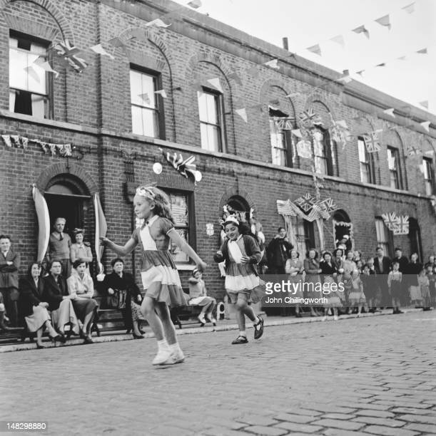 Children competing in an eggandspoon race at a party to celebrate the coronation of Queen Elizabeth II held in Morpeth Street in London's East End...