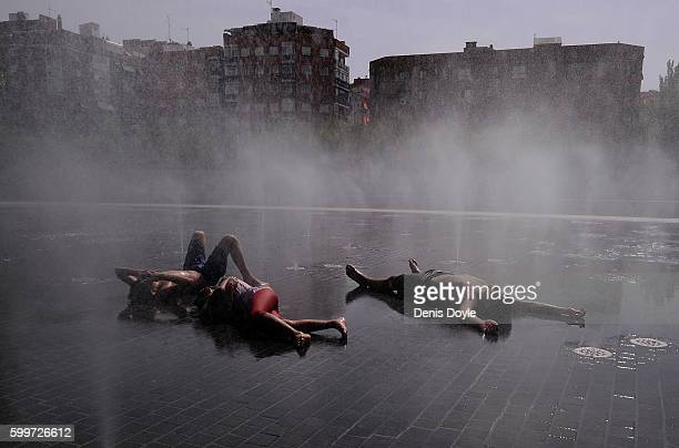 Children cool down in a fountain in the Madrid Rio playground on September 6 2016 in Madrid Spain A threeday heatwave has hit central and southern...
