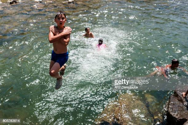 Children cool off in the river Vit near Teteven on July 1 as temperatures reach 44 degrees Celsius Five people died on July 1 as soaring temperatures...