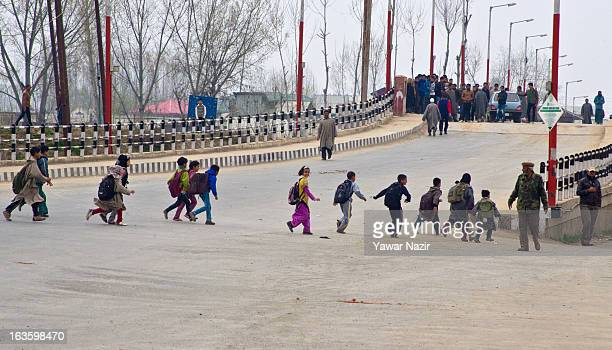 Children cross a road near a police public school after an attack on Indian forces by rebels caused a gunfight between the two sides near the school...