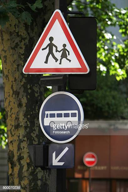 Children crossing sign and bus sign