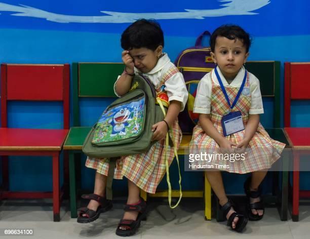 Children crying on the first day of school at Sane Guruji English Medium High School in Dadar on June 15 2017 in Mumbai India Attired in brandnew...