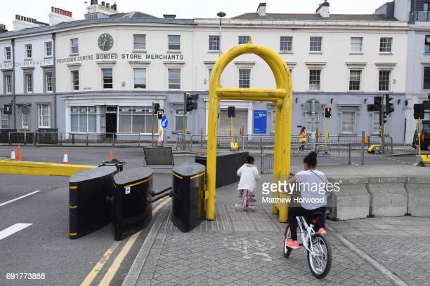 Children cycle through security barriers at the UEFA Champions Festival at Cardiff Bay on June 2 2017 in Cardiff Wales On Saturday Juventus will play...