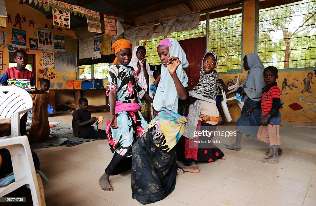 Children dance in a childfriendly space in the Dadaab refugee camp in Kenya July 14 2014 Save the Children established the space as a safe and...