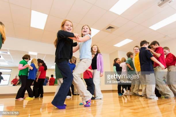 Children dancing in gym class